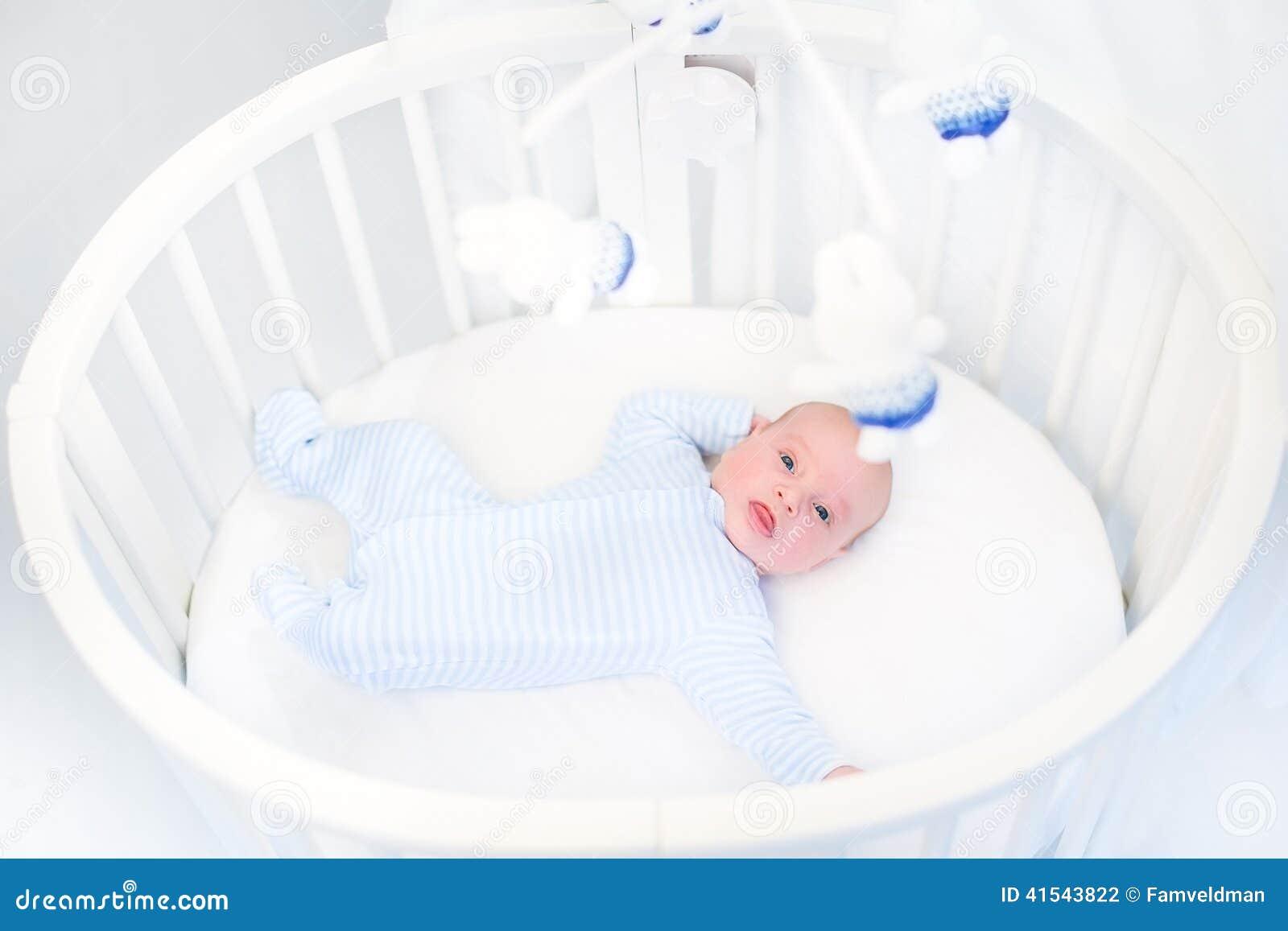 Cute Newborn Baby Boy In A White Round Crib Stock Photo - Image ...