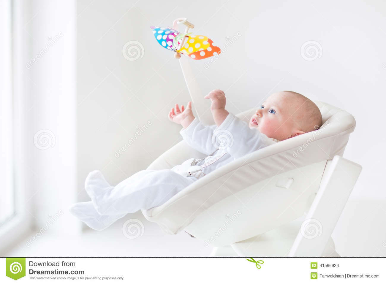 Cute Newborn Baby Boy Watching Colorful Mobile Toy Stock