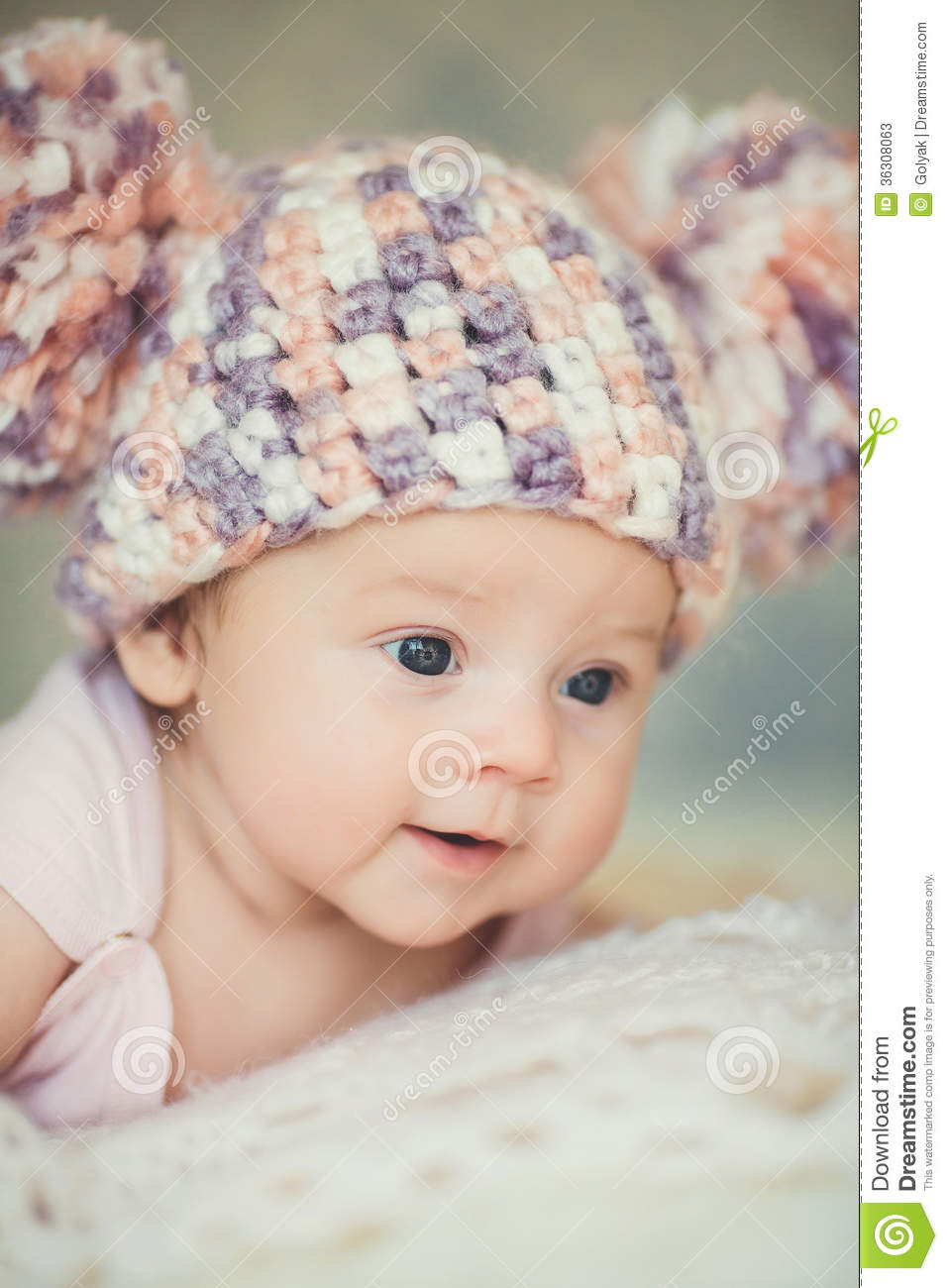 cute newborn baby girl in knitted cap with bubonic stock image