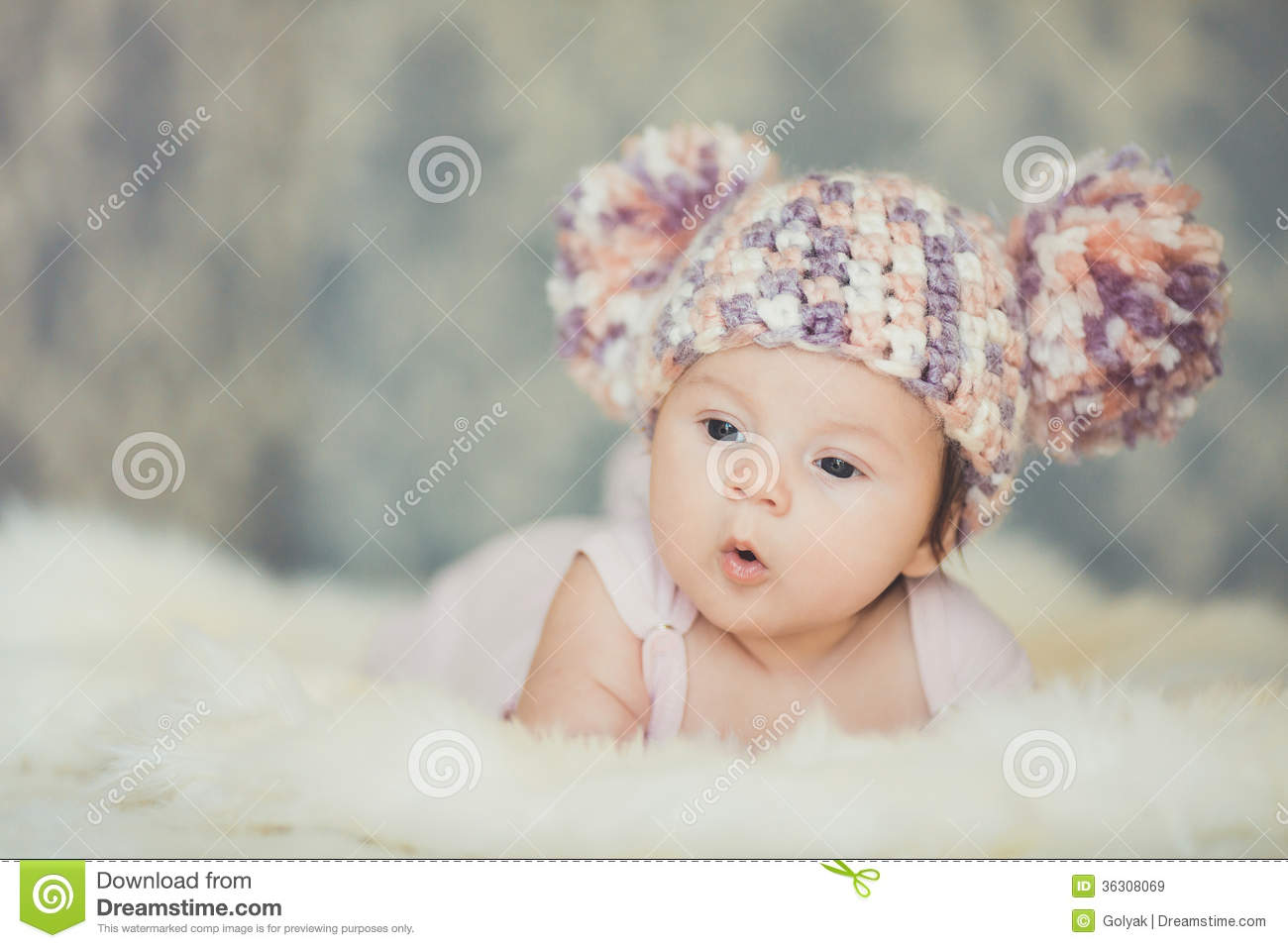 Cute Newborn Baby Girl In Knitted Cap With Bubonic Royalty