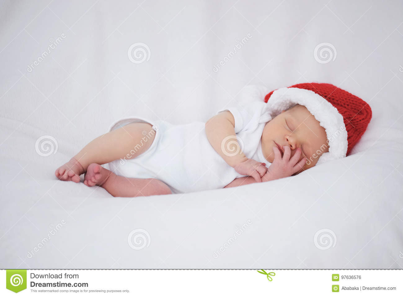 4624830d9a6 Photo of cute newborn baby with santa hat. More similar stock images