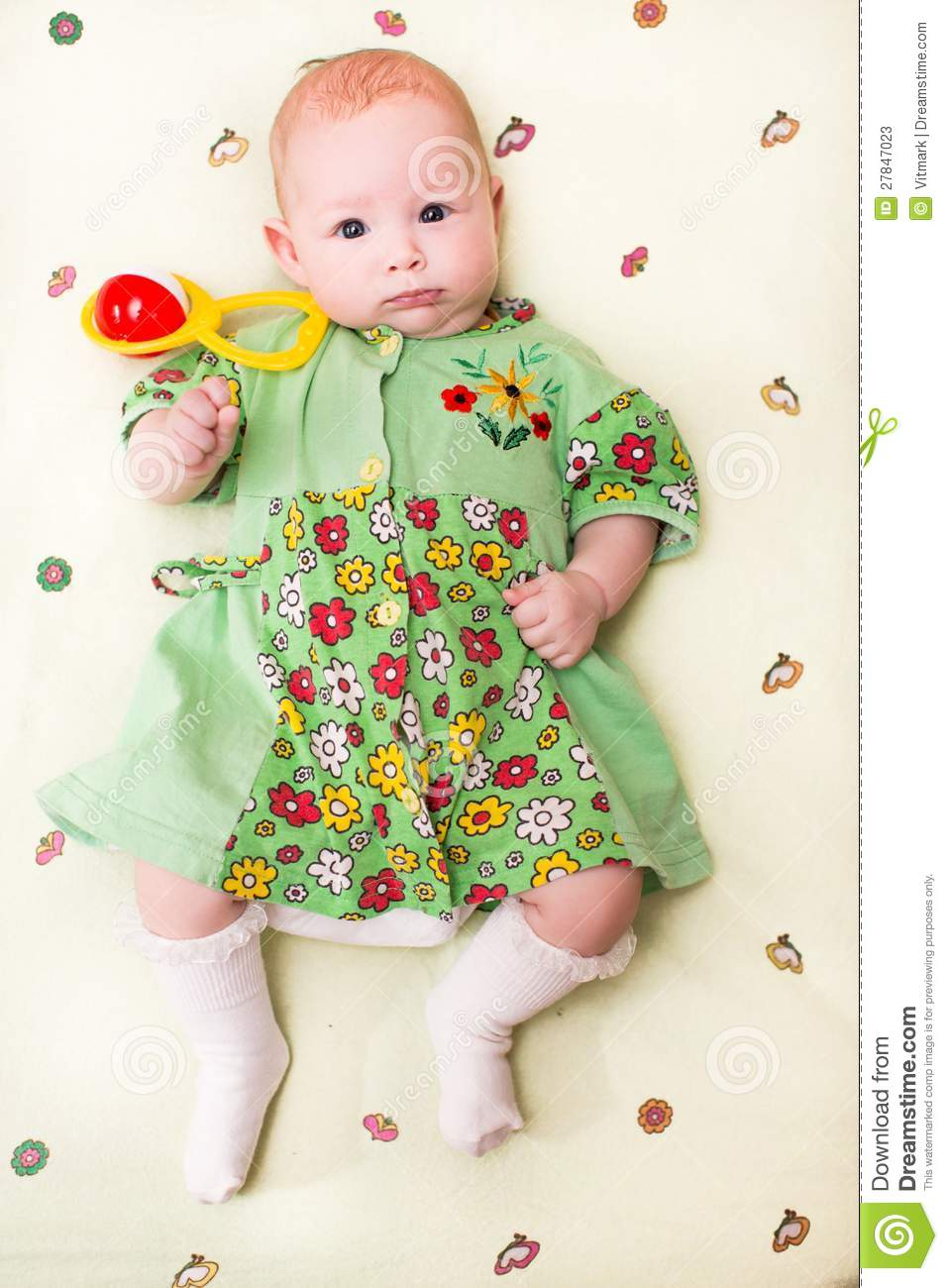 Newborn Baby Girl Toys : A cute newborn little baby girl with toy stock image