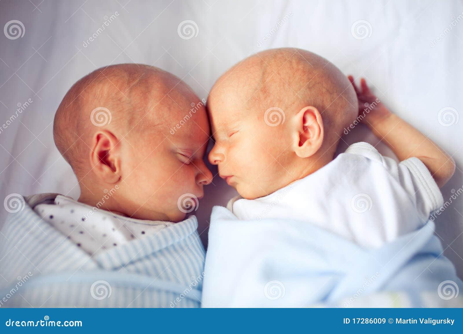 Cute Newborn Twins Sleeping And Bonding Royalty Free Stock ...