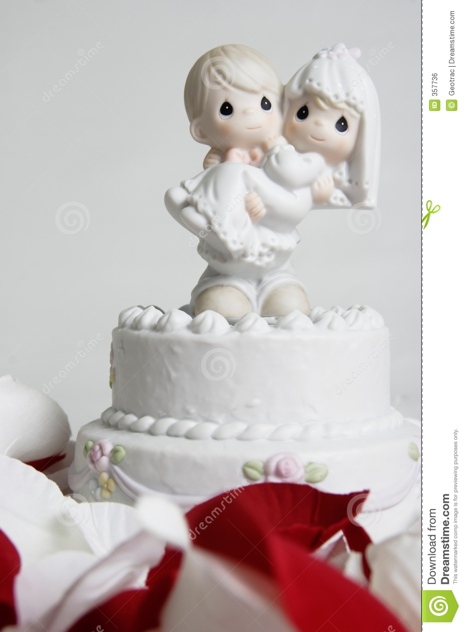 Cute Ornament Of Groom Carrying Bride On Top Of Wedding Cake Stock ...
