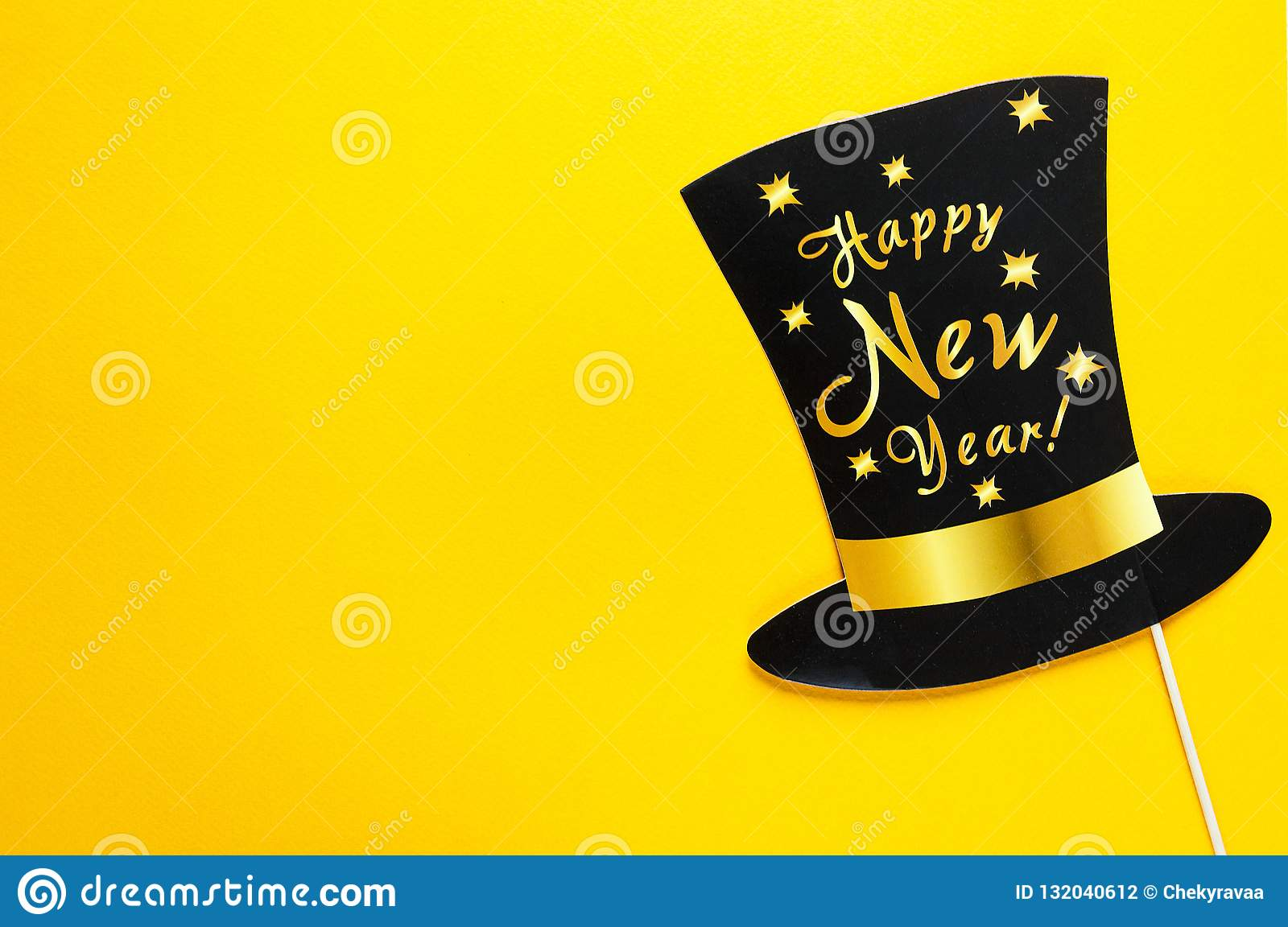 Cute party props accessories on colorful yellow background, happy new year party celebration and holiday concept