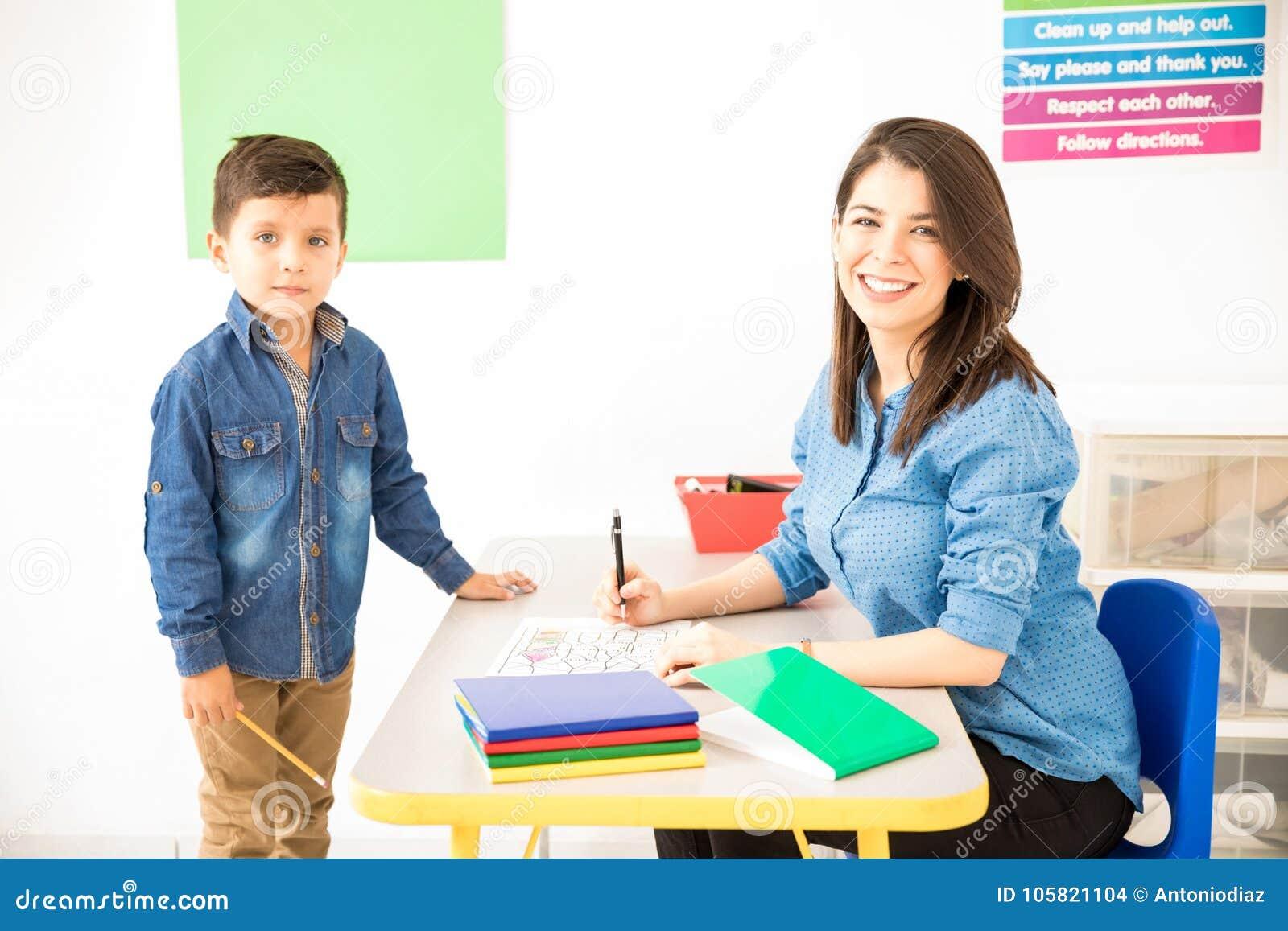 cute preschool teacher grading student s work stock photo image of