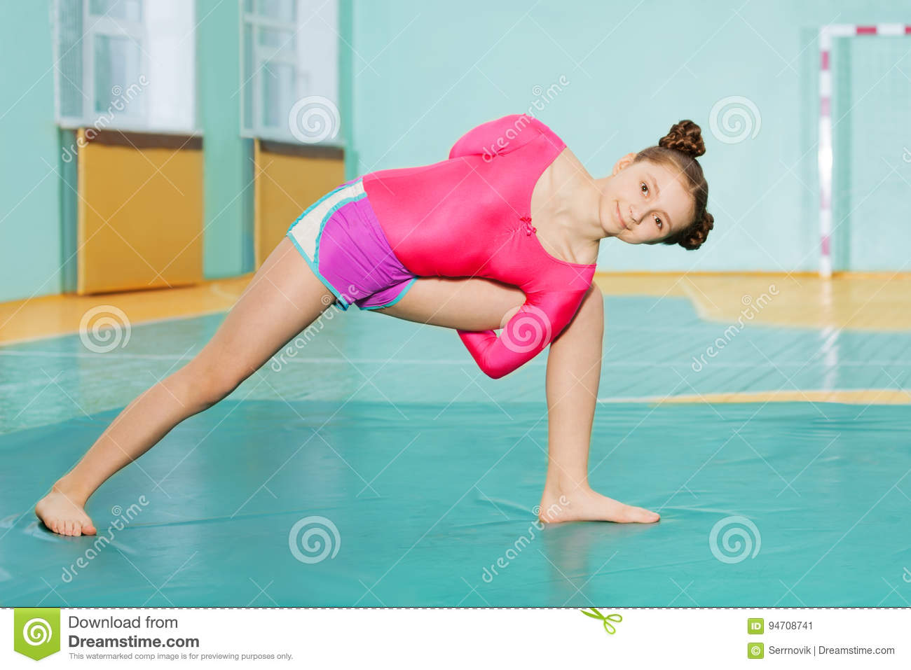 Cute Preteen Girl Doing Stretching Exercise On Mat Stock