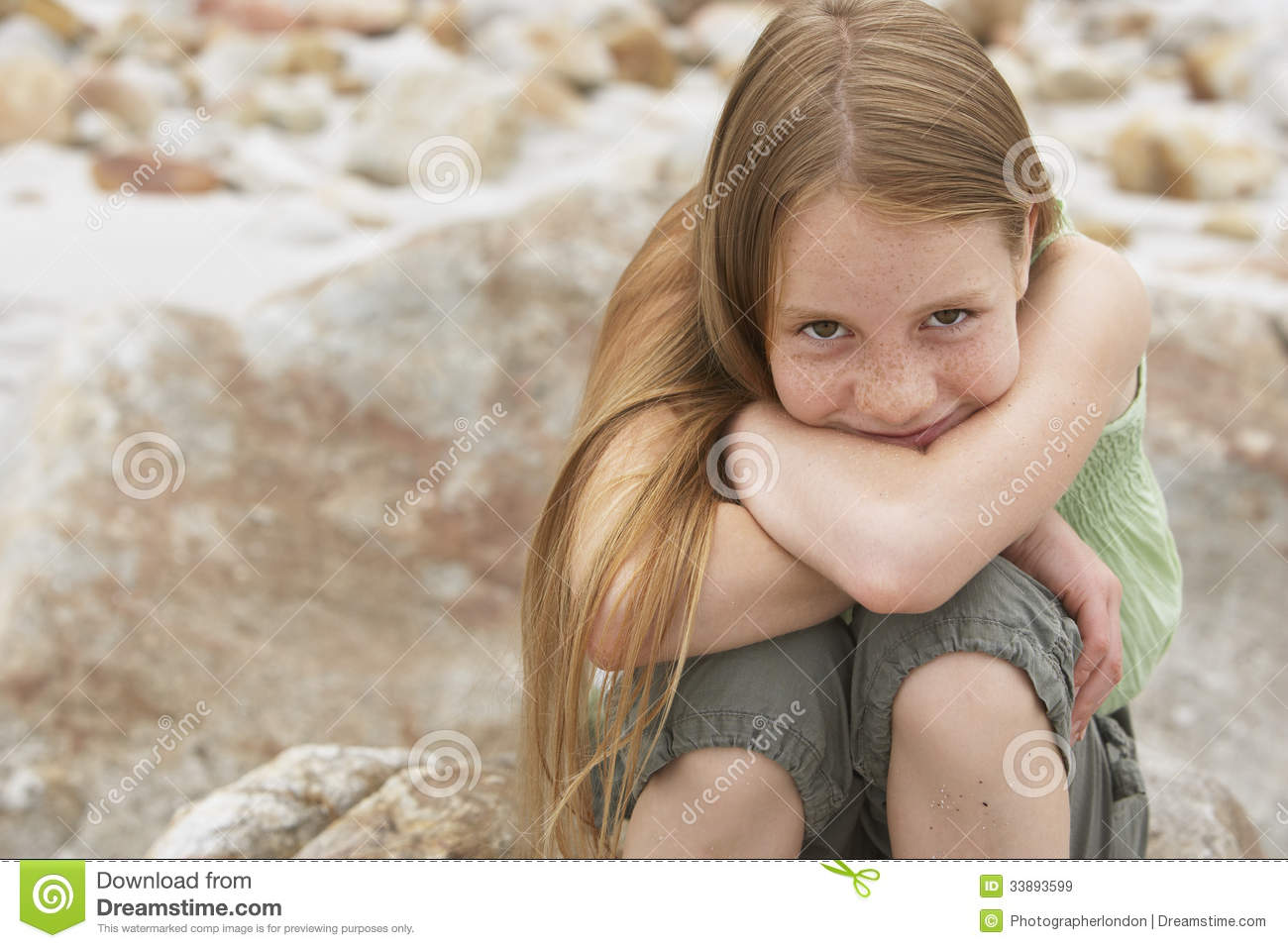 Girl sitting on rock see
