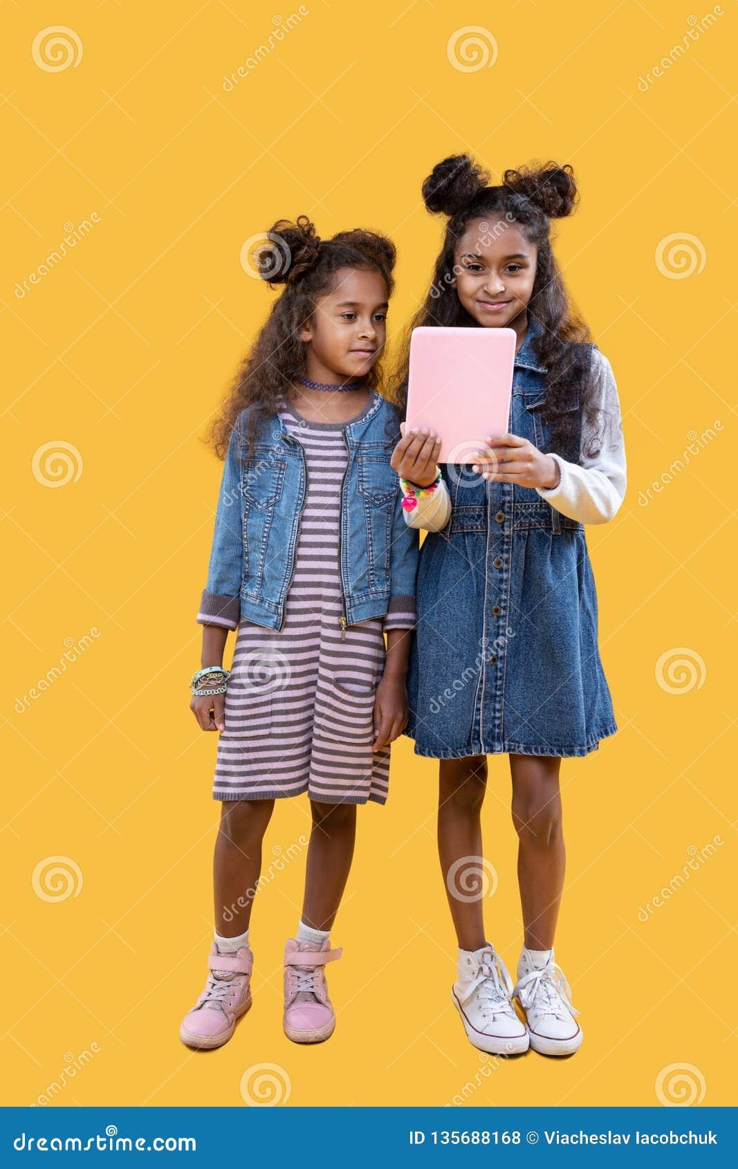 Cute pretty young girls using modern technology