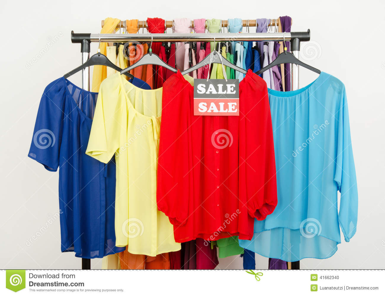 Cute Red, Yellow, Blue Blouses Displayed On Hangers With The Sale ...