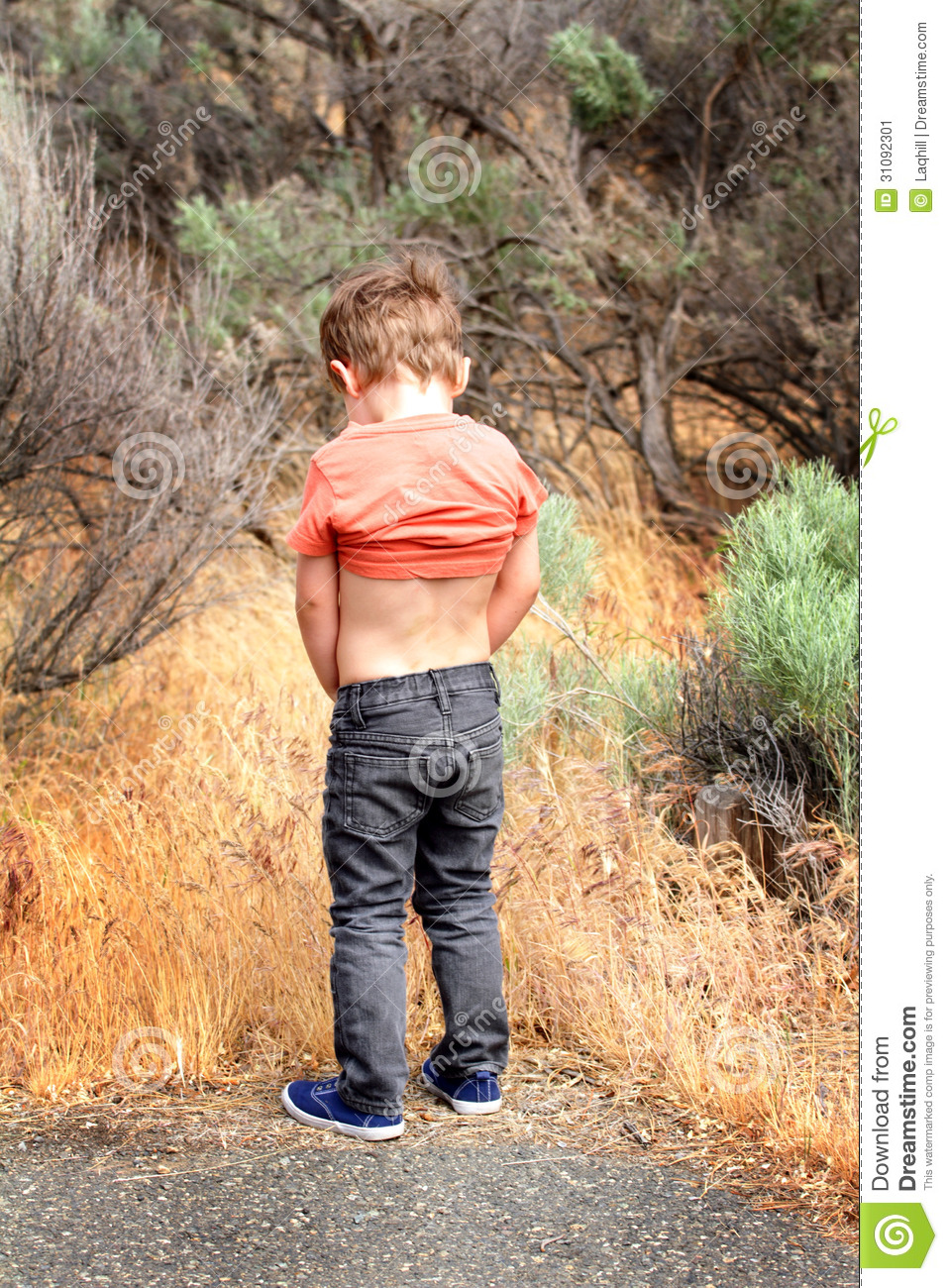small boy pissing photo