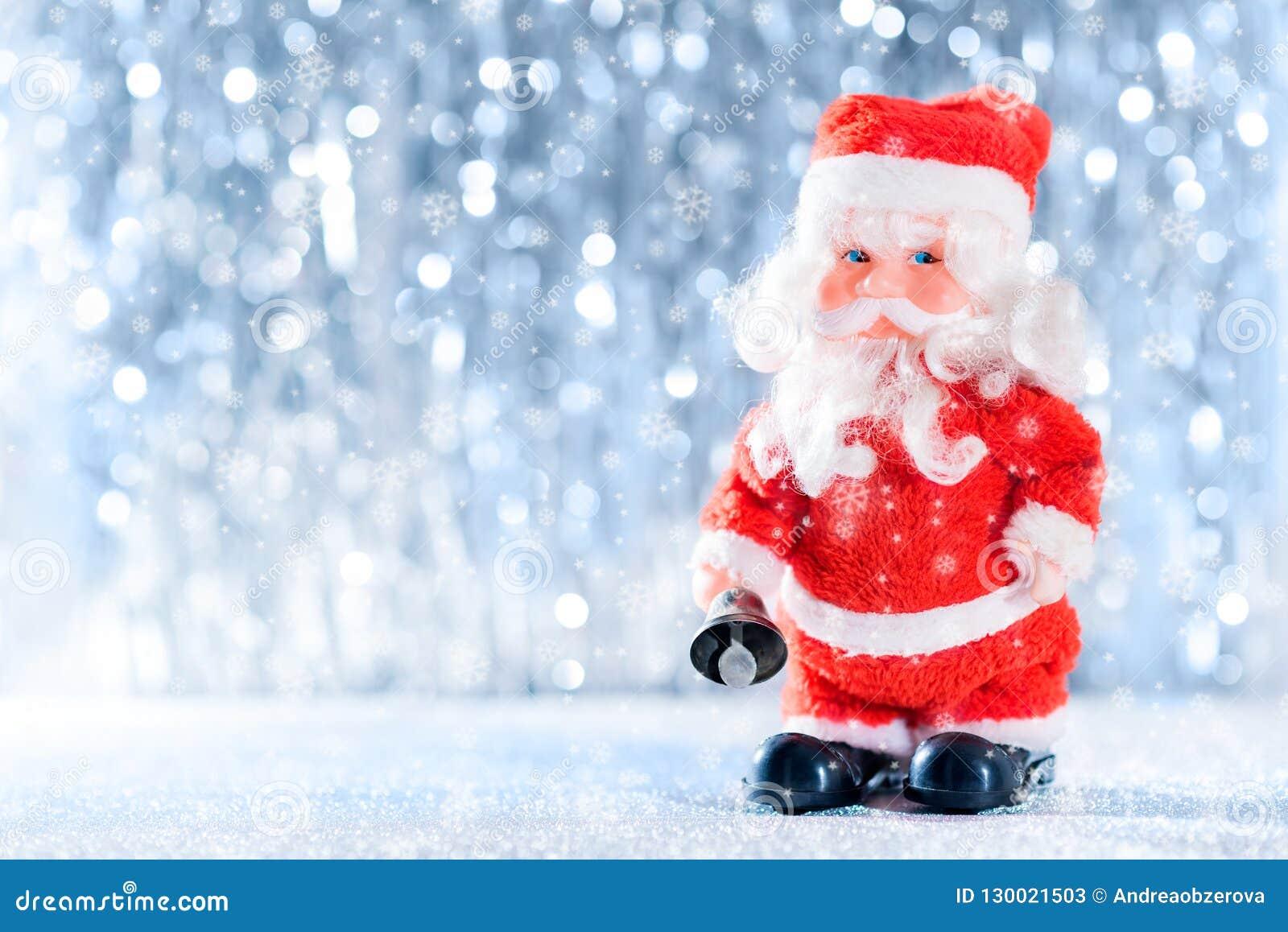 Cute Santa Clause in Winter Wonderland. Christmas background.