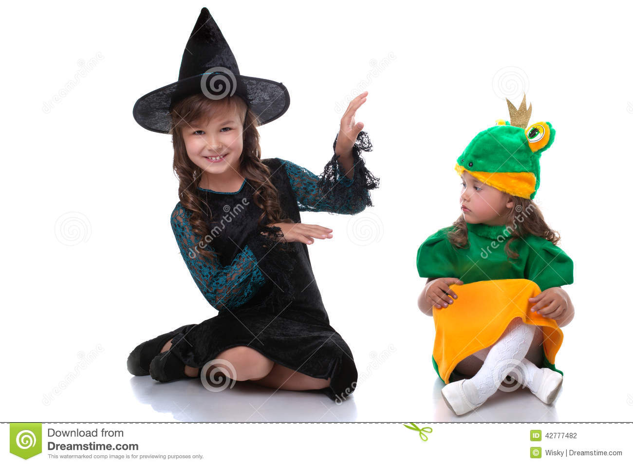 Cute Sisters Posing In Costumes Of Witch And Frog Stock Photo ...