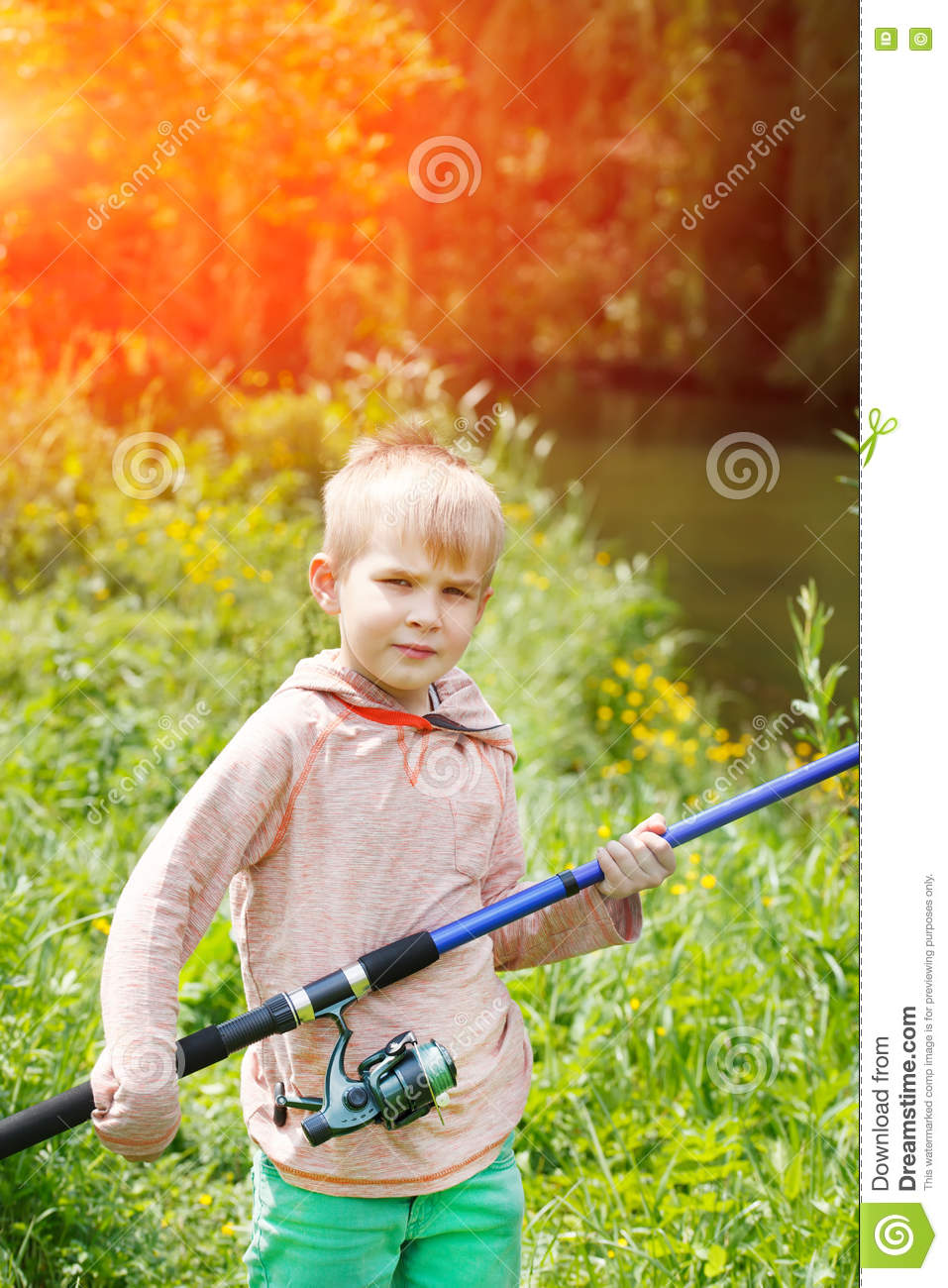 Boy near log fishing at shallow pond royalty free stock for Pond equipment near me