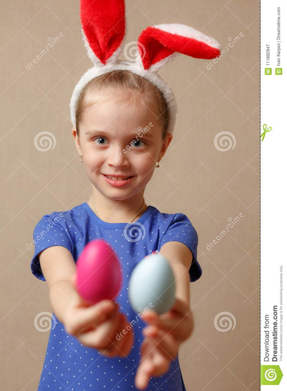 Cute smiling little girl with colorful easter eggs. Happy easter. selective focus