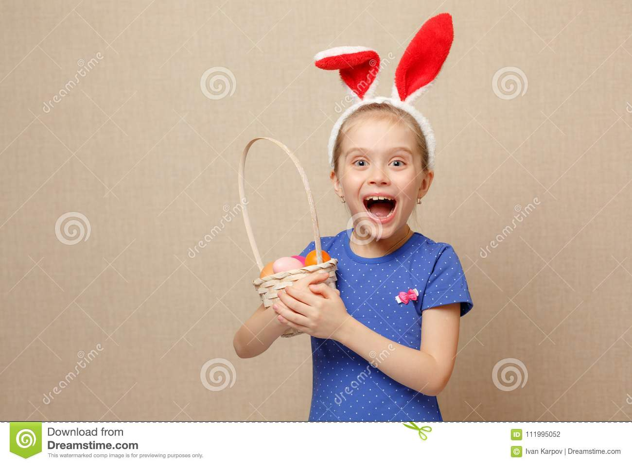 Little girl with basket Easter eggs