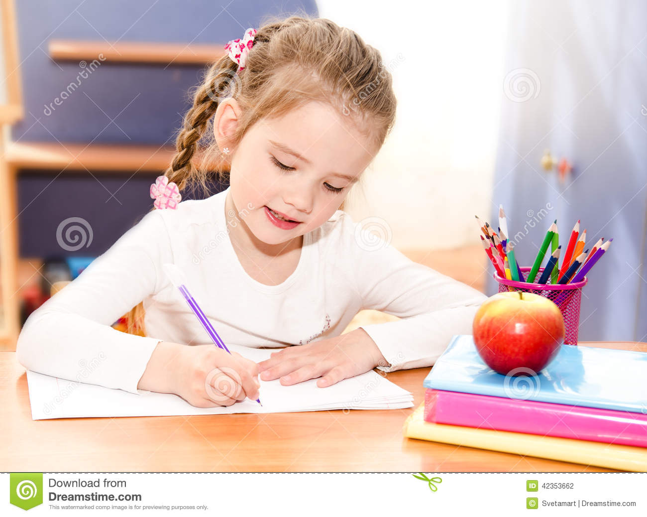 Cute smiling little girl is writing at the desk stock photo image 42353662 - Desk girl image in ...