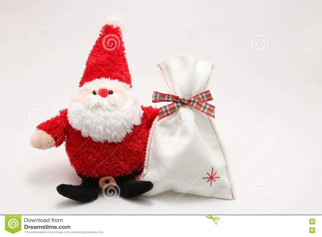 Cute Stuffed Toy Santa Claus And Present On White Background Stock
