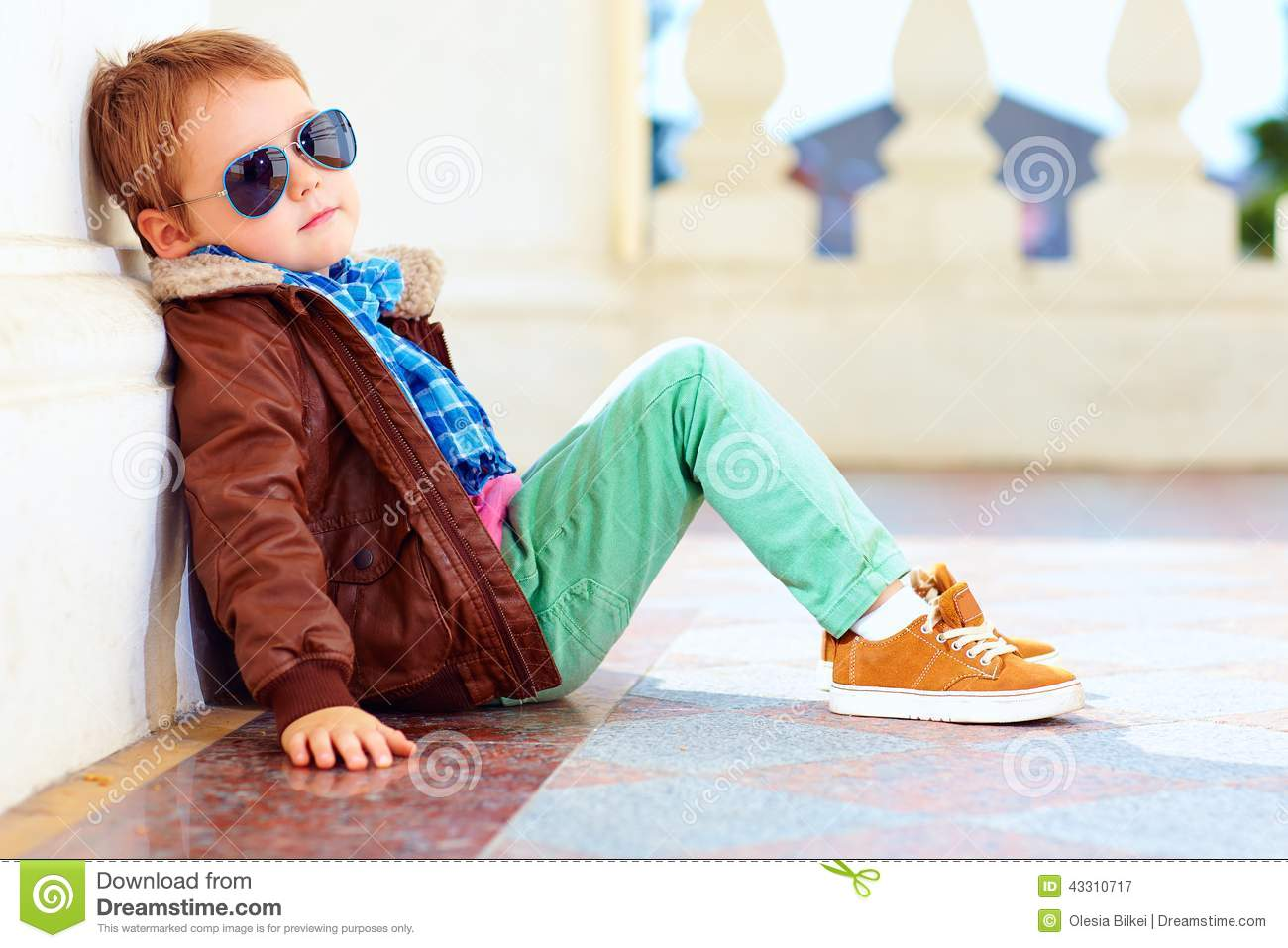 cute stylish boy in leather jacket and gum shoes pilot bomber