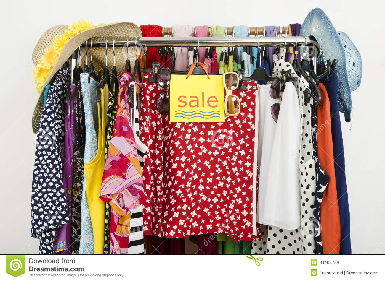 cute summer outfits displayed on hangers with a big sale sign stock image image of nobody. Black Bedroom Furniture Sets. Home Design Ideas