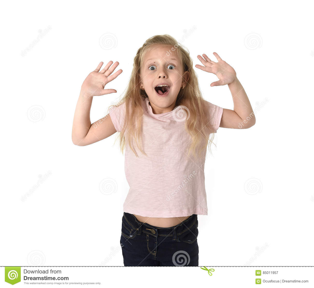 cute and sweet little girl in disbelief and surprise face expression looking amazed in schock