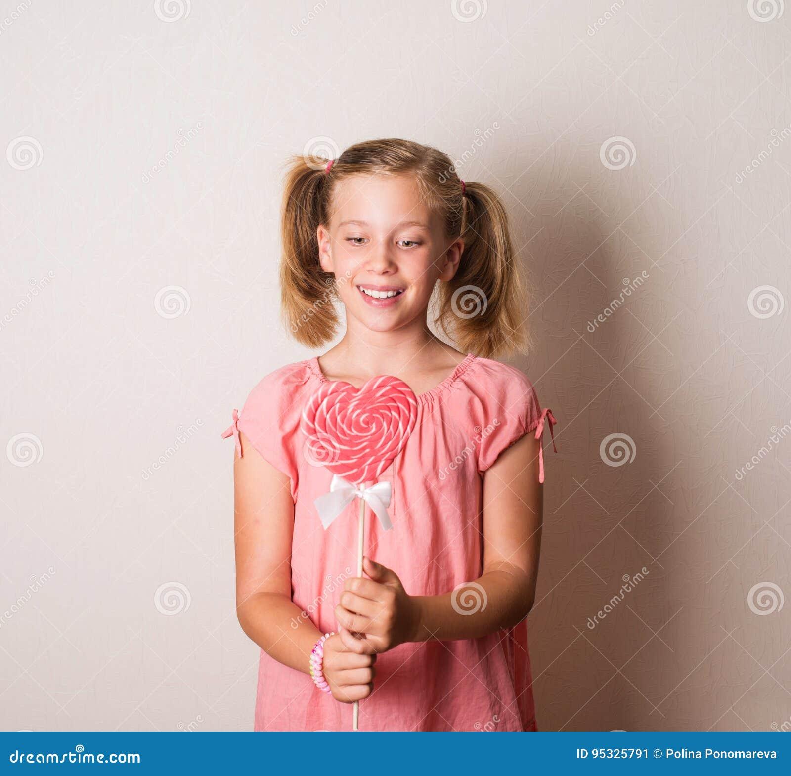 marvelous Cute Little Teen Girls Part - 6: Beautiful little girl holding a big heart shaped lollipop