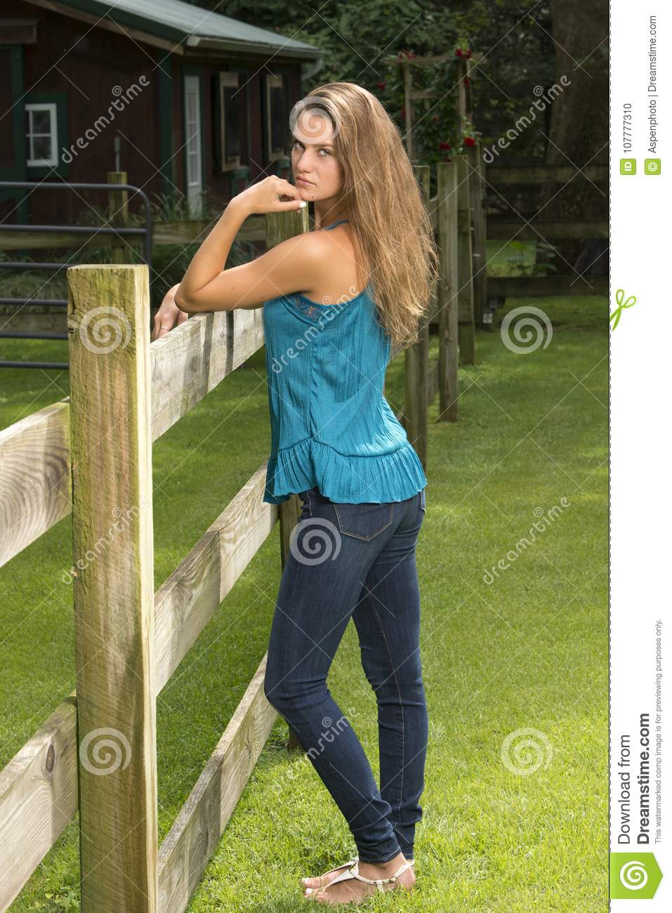 Beautiful Teen Girl Poses In Jeans And Blouse On Farm Rural Setting
