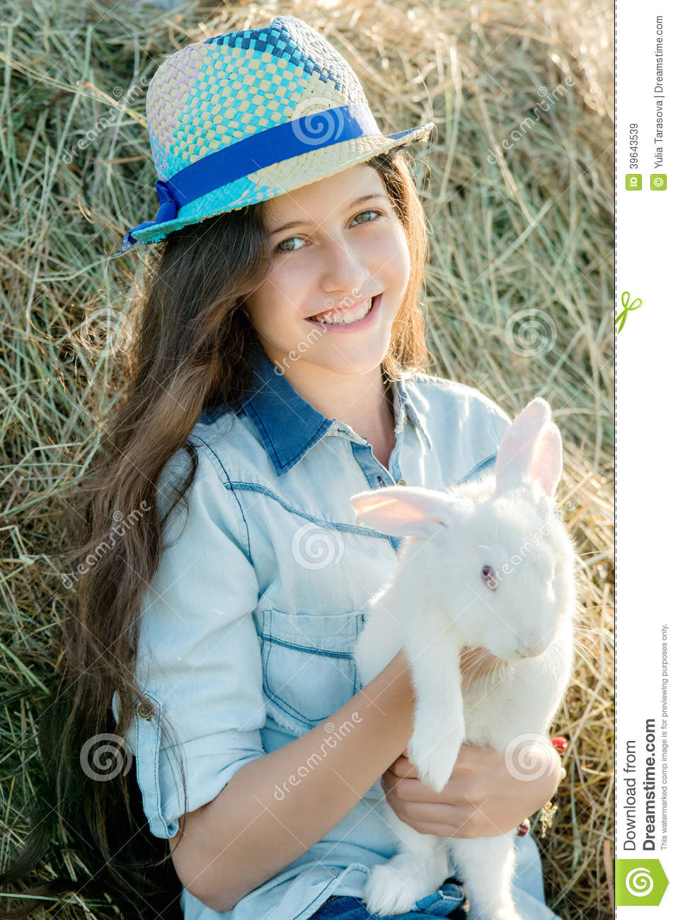 Cute Teen Girl With White Rabbit Sitting In Front Of