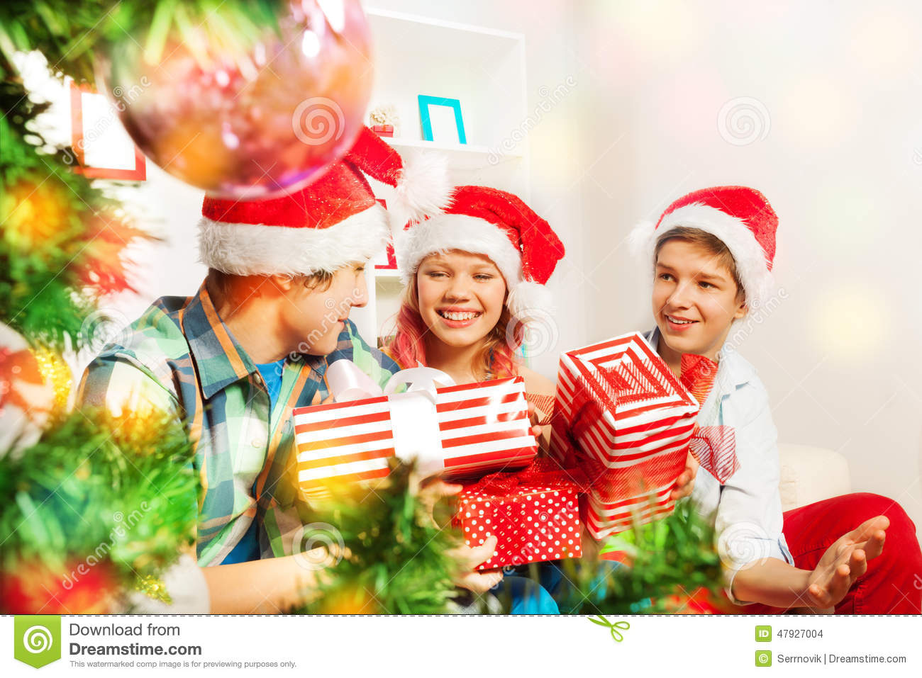 Cute Teen Kids Holding Christmas Presents Stock Photo - Image of ...