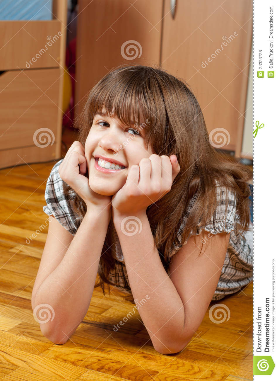 Cute teenage girl lying on the floor royalty free stock for Cute teenager girls