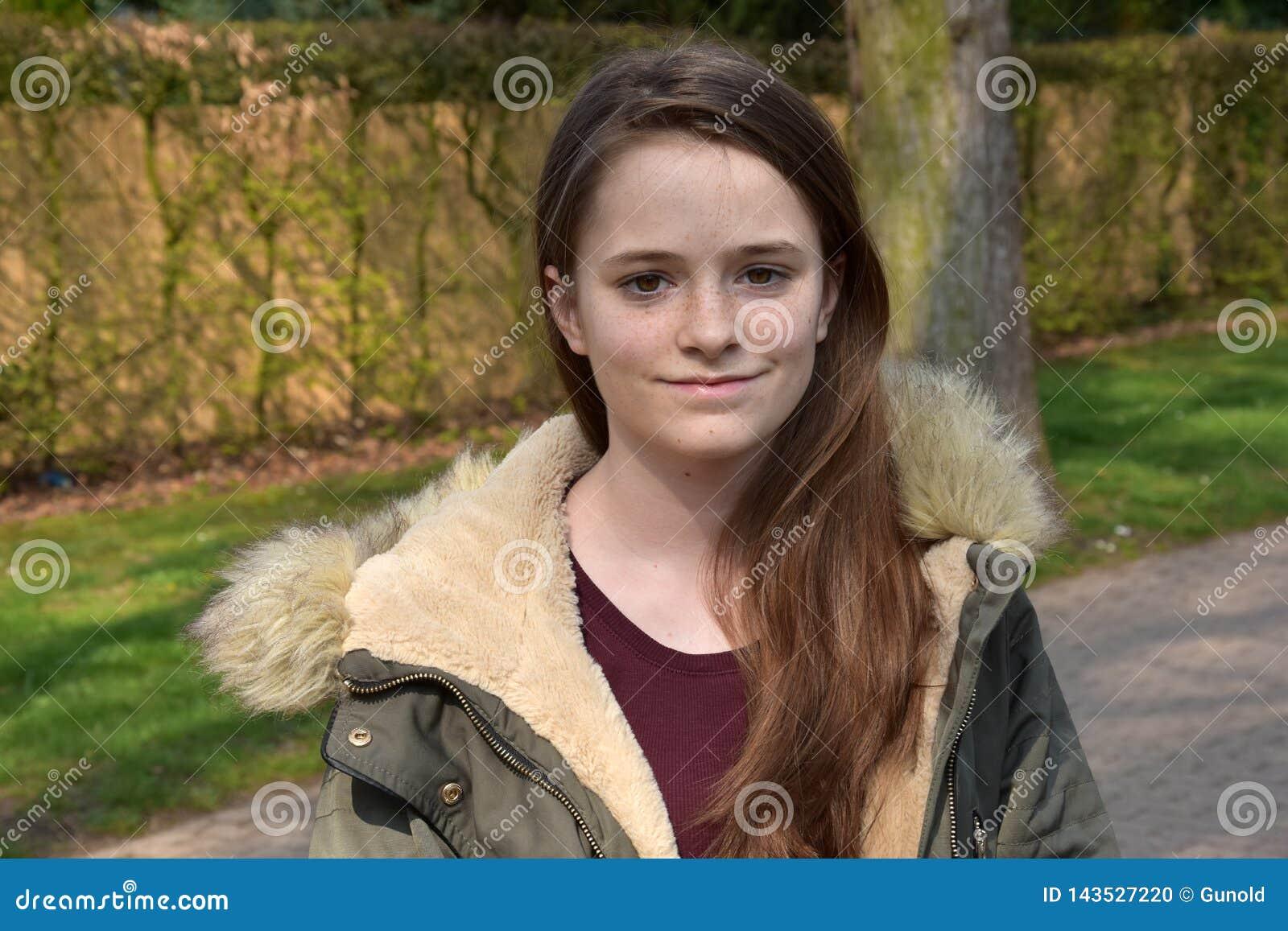 Cute teenage girl with winter jacket