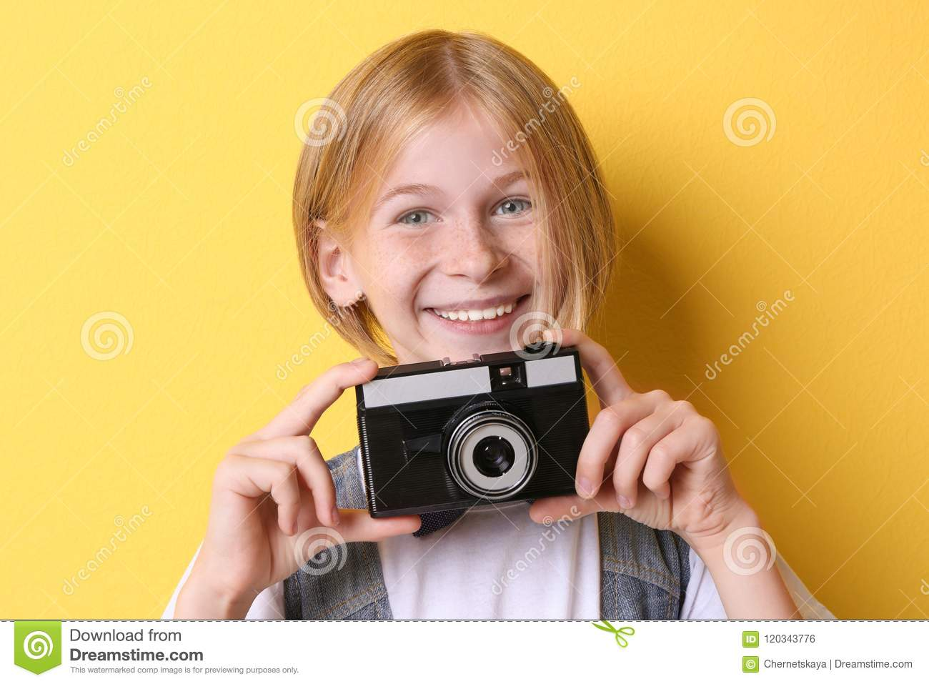 204949dc1032 Funny Teenager Girl With Camera On Yellow Background Stock Photo ...