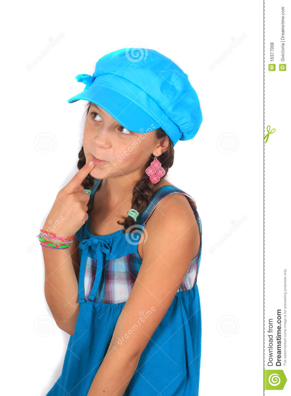 Pretty ten year old adolescent girl with braids and colorful blue