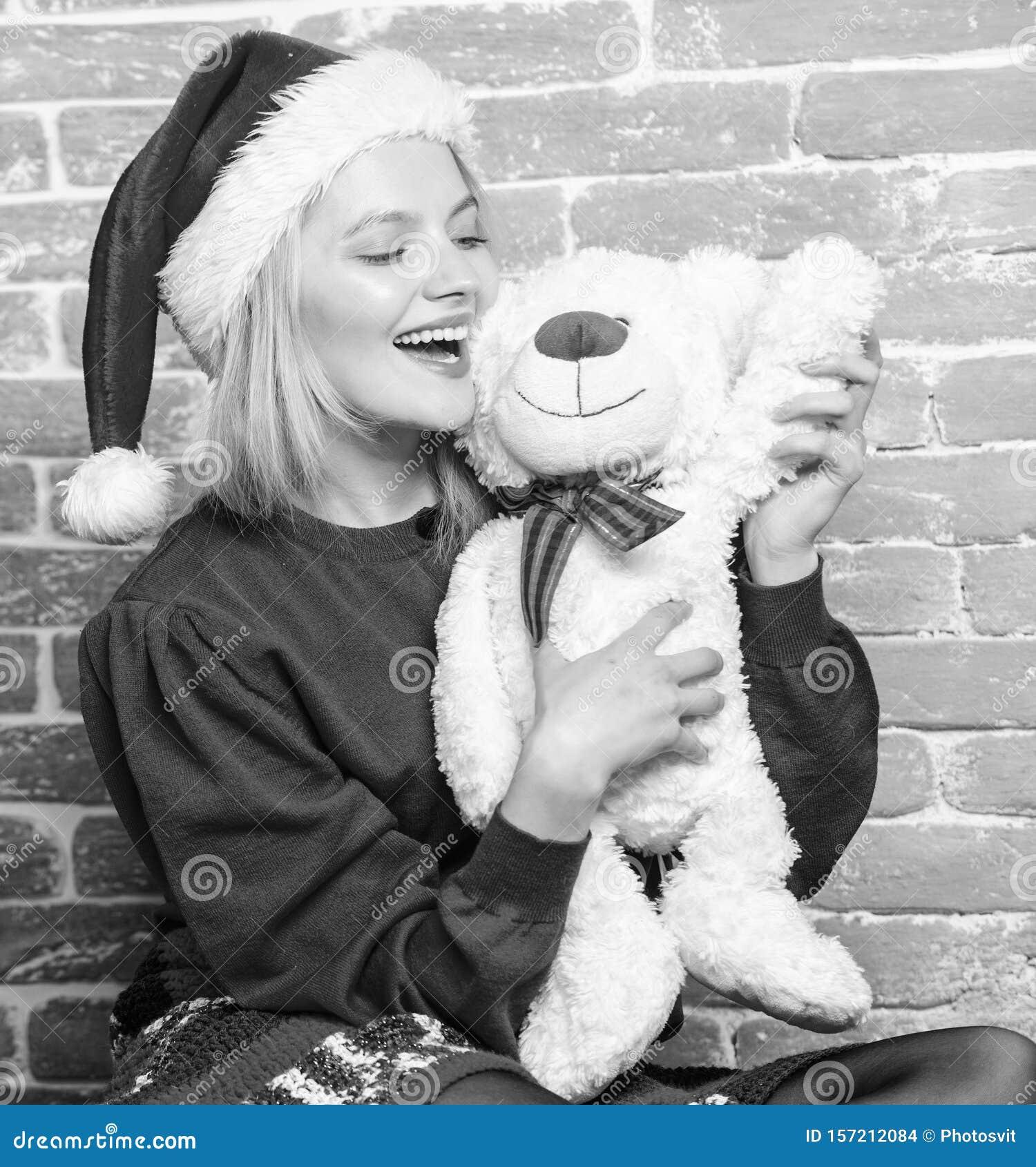 Cute And Tender Gift. Woman Santa Hat Hug Soft Toy Bear ...