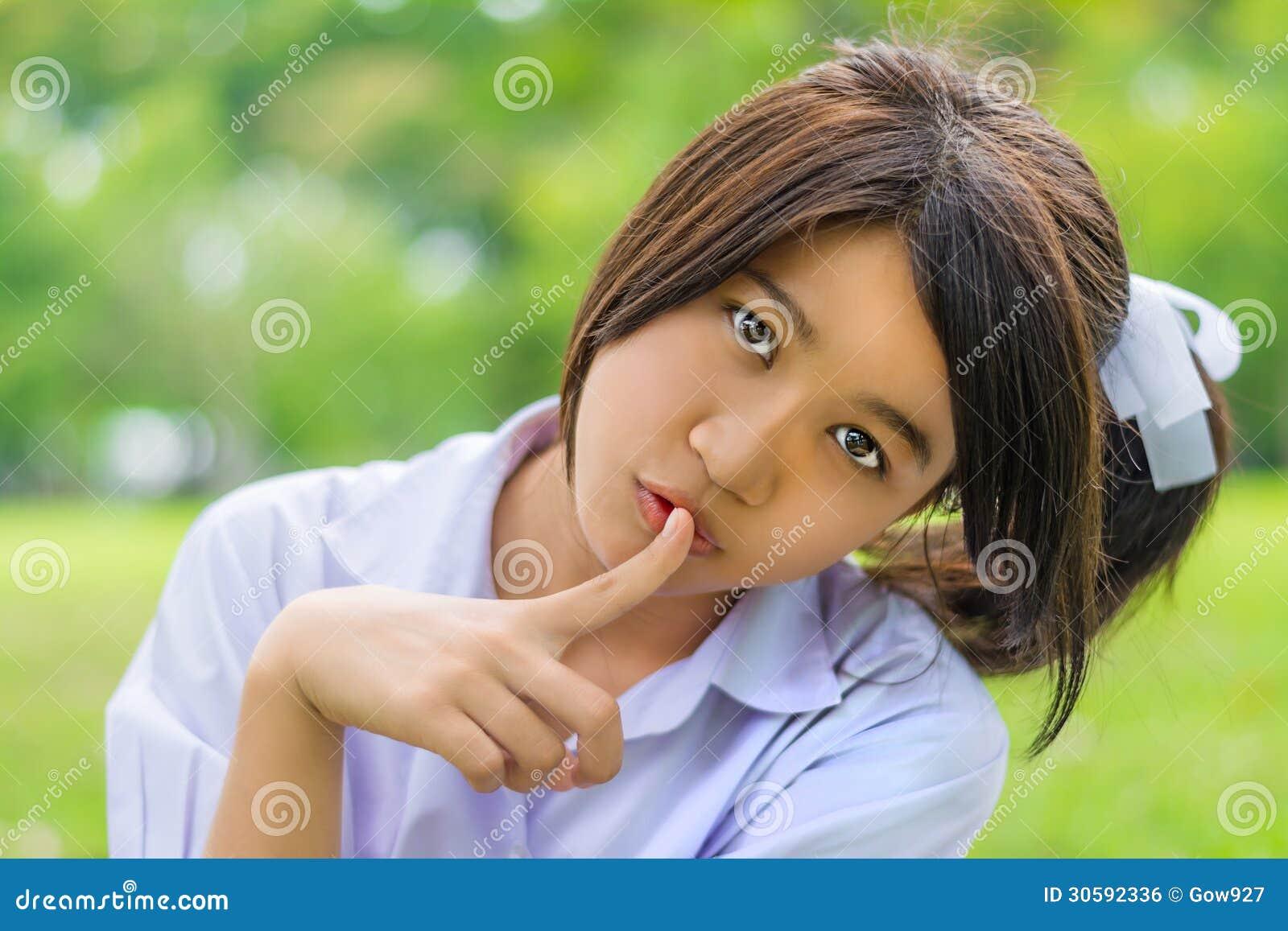 Cute thai schoolgirl hush gesture royalty free stock for 15 year old girl cute