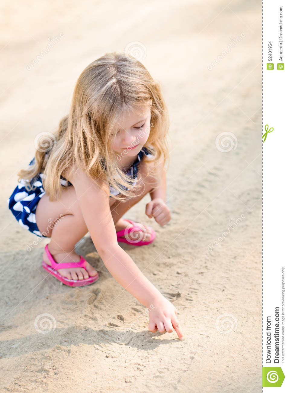 Cute Thoughtful Little Girl With Long Blond Hair Squatting