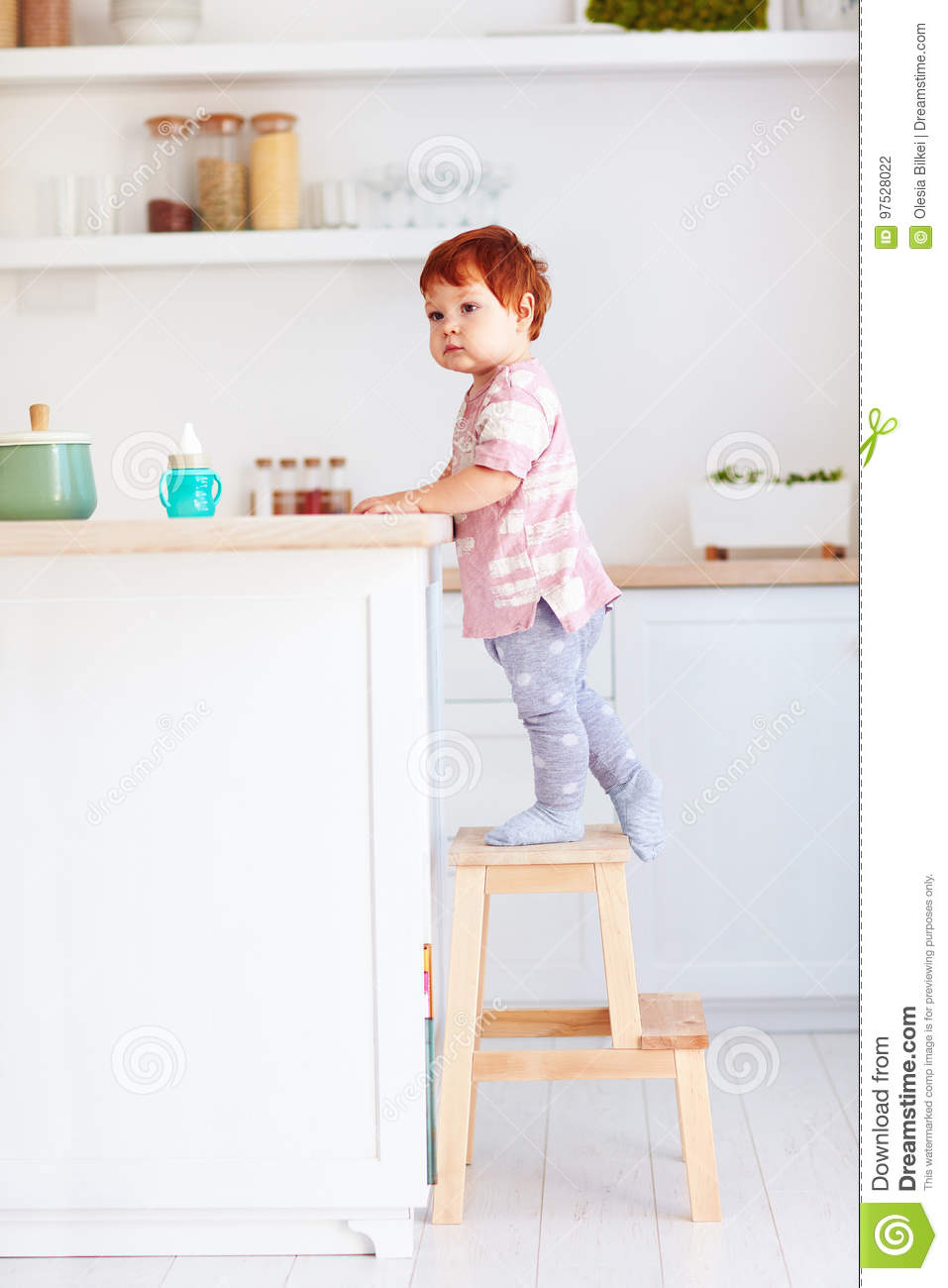 Awesome Cute Toddler Baby Climbs On Step Stool Trying To Reach Theyellowbook Wood Chair Design Ideas Theyellowbookinfo