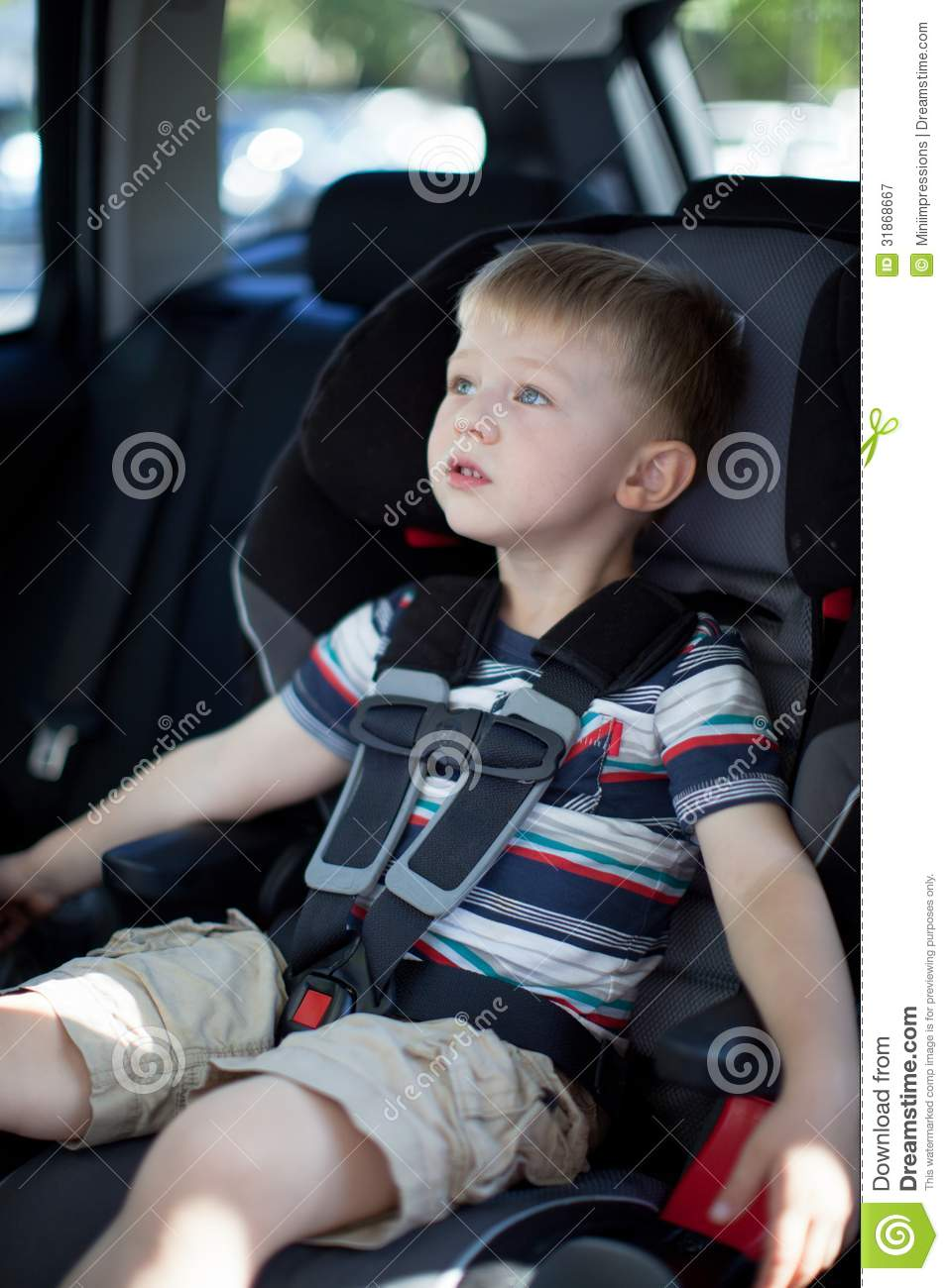 Cute Toddler Boy Buckled Up In A Convertible Car Seat