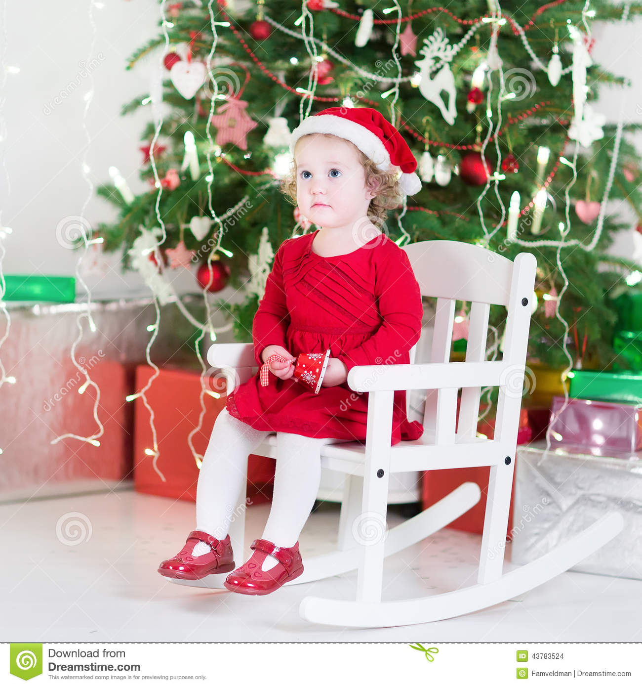 Little Girl Christmas Tree: Cute Toddler Girl In Red Dress And Santa Hat Near