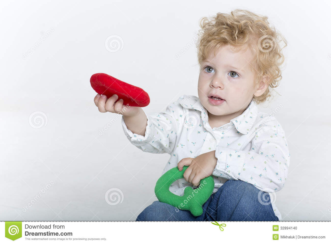 Cute toddler is playing with letters stock photo image 32894140