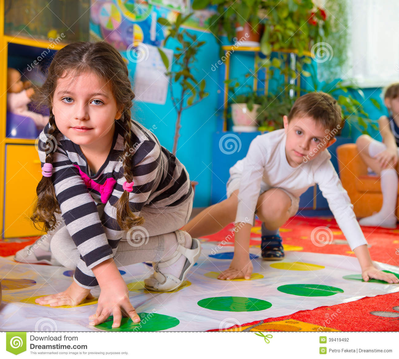 Kinder Garden: Cute Toddlers Playing In Twister Game Stock Photo