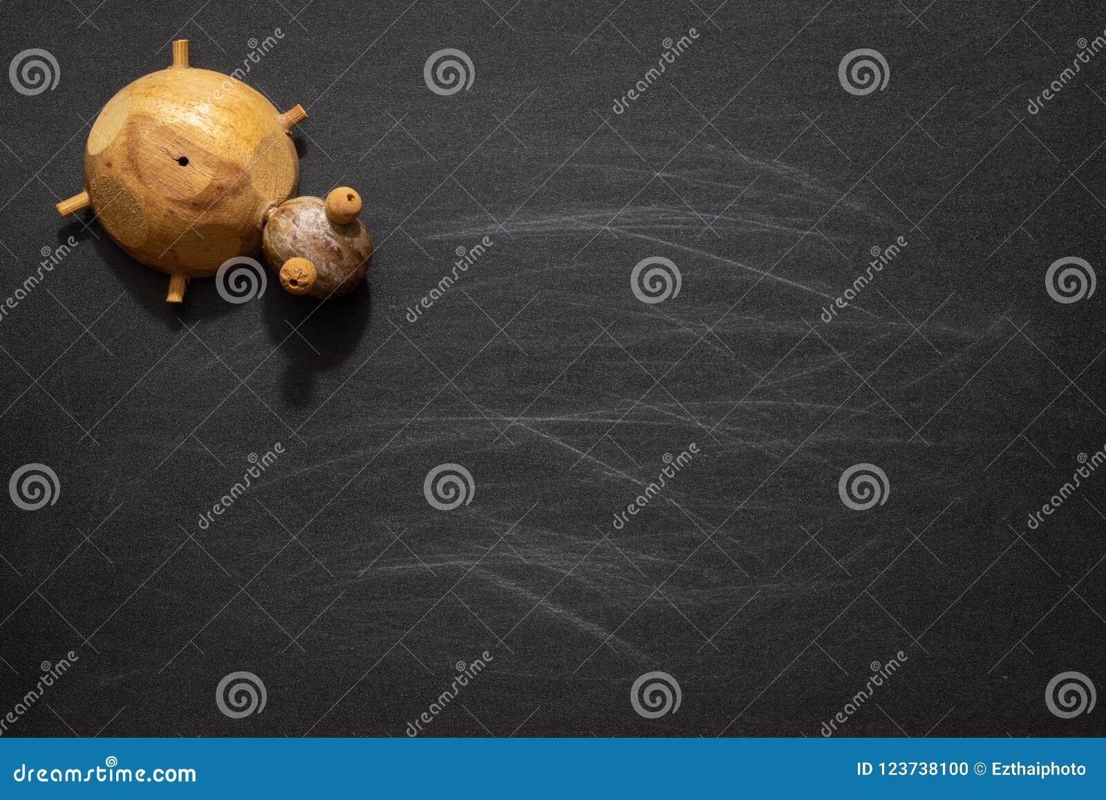 cute turtle toys on black chalkboard with blank copy space idea
