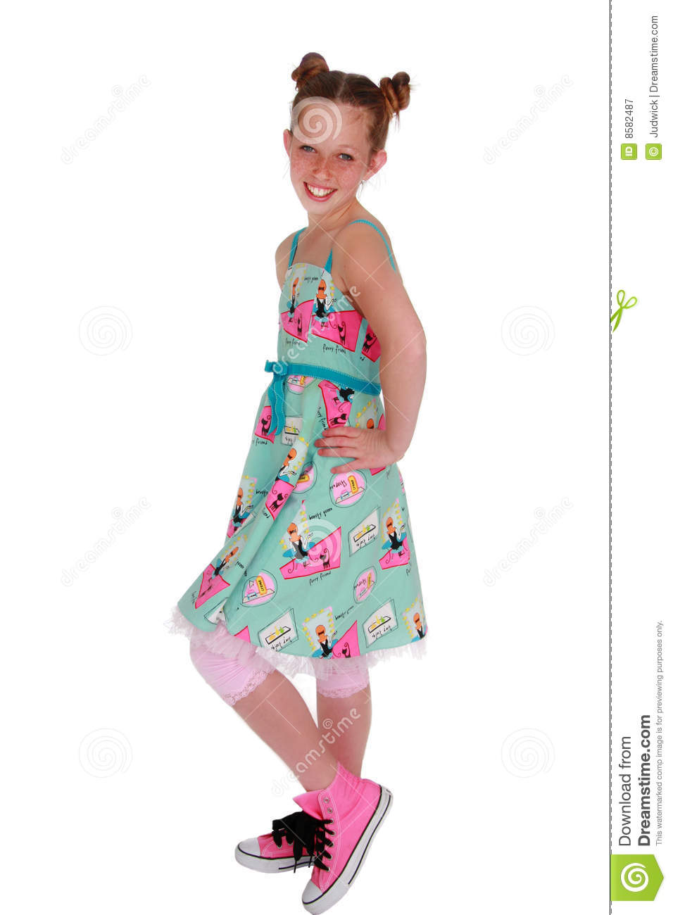 cute freckled tween girl in bright colorful 50 s style dress