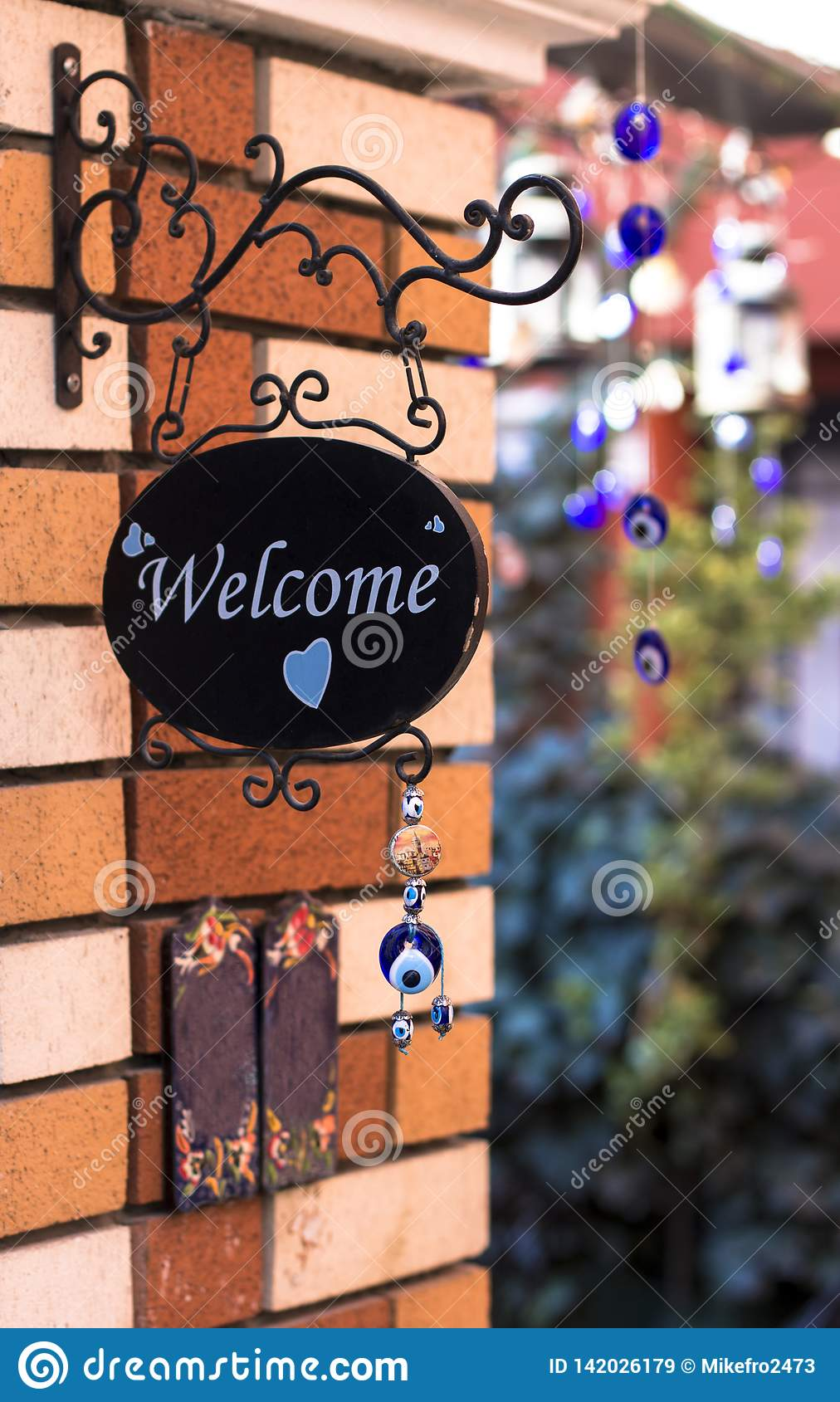 Cute welcome sign on the brick wall