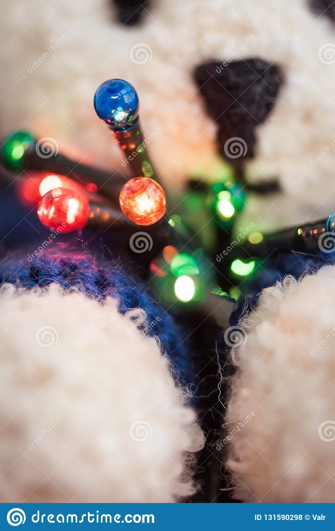 Cute white teddy bear with Christmas lights