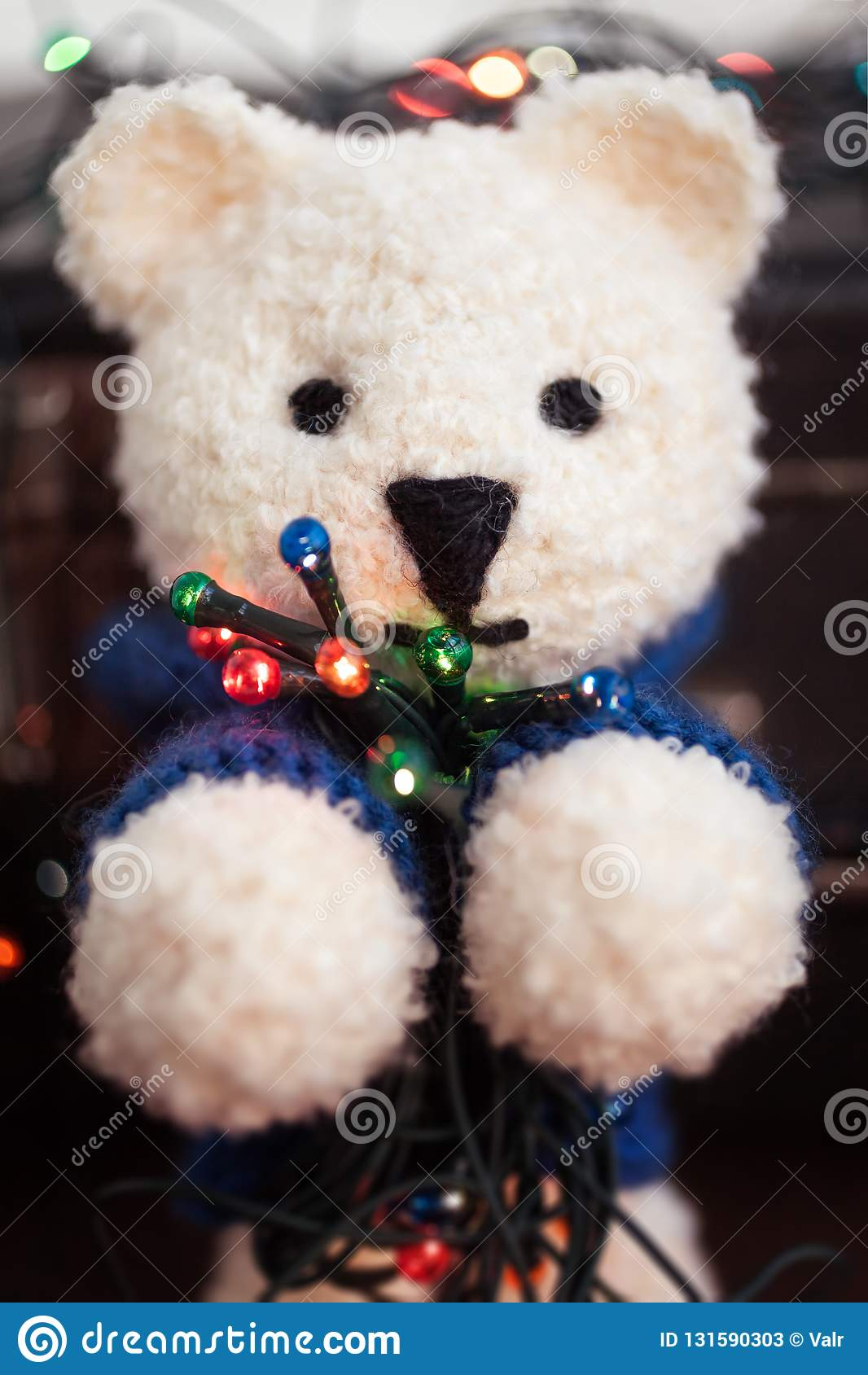 Cute white teddy bear with Christmas lights