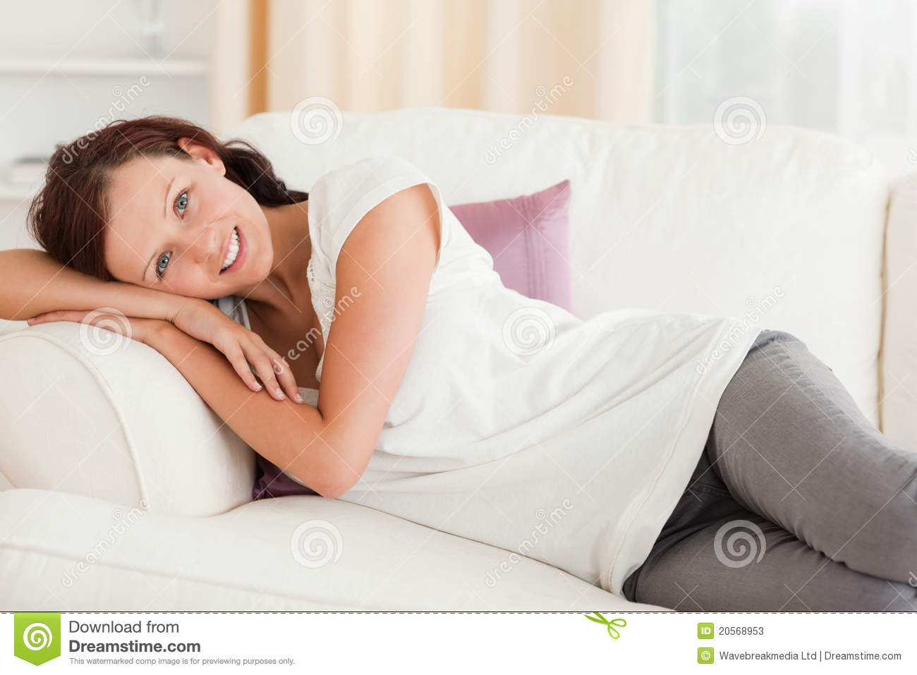 Cute Woman Relaxing On Her Sofa Stock Photos Image 20568953