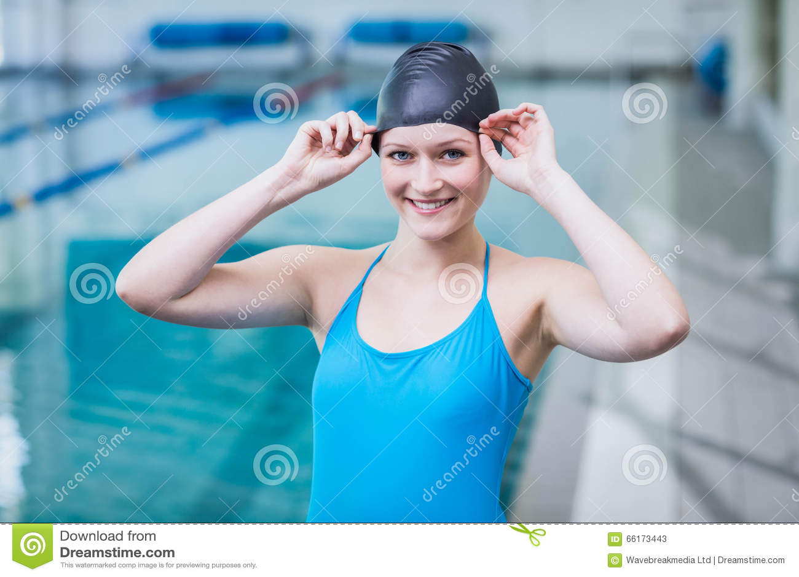 Cute woman wearing swim cap