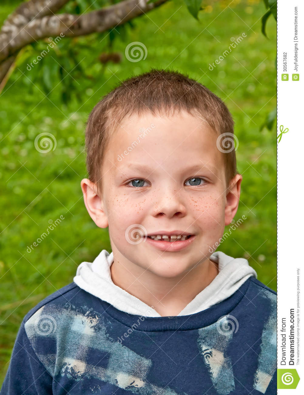 8 Year Boy Bedroom Design: Cute 8 Year Old Caucasian Boy Smiling Stock Photo