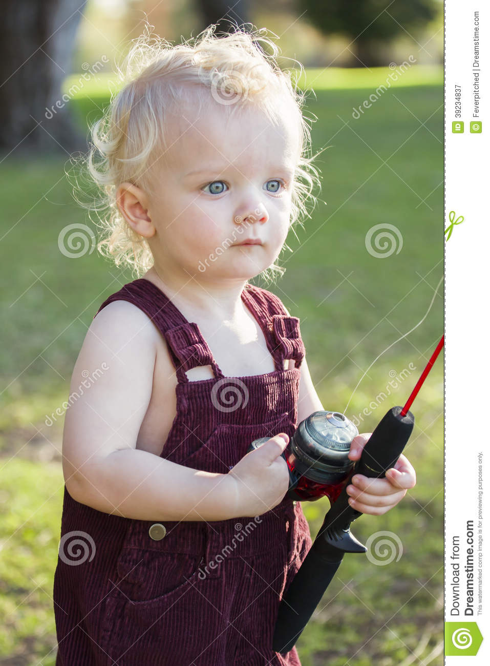 Cute Young Boy With Fishing Pole at The Lake